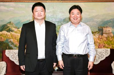 国文清会见华发集团董事长,总经理李光宁